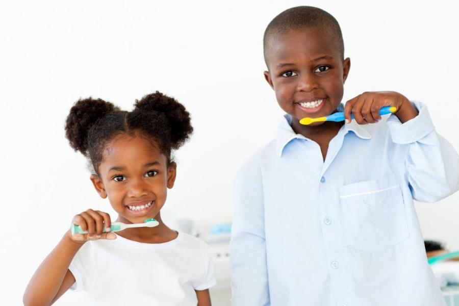 Image of children brushing teeth.