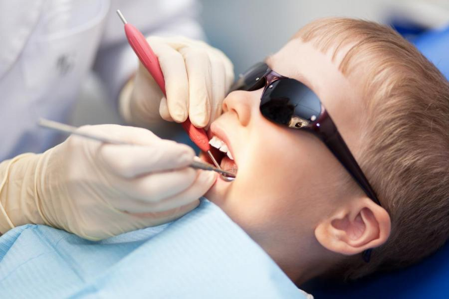 Image of child at the dentist.